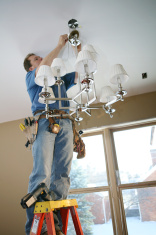 stock-photo-4909884-electrician-installing-chandelier