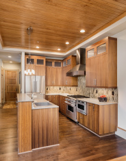stock-photo-69550461-kitchen-in-new-luxury-home-with-dark-wood-throughout
